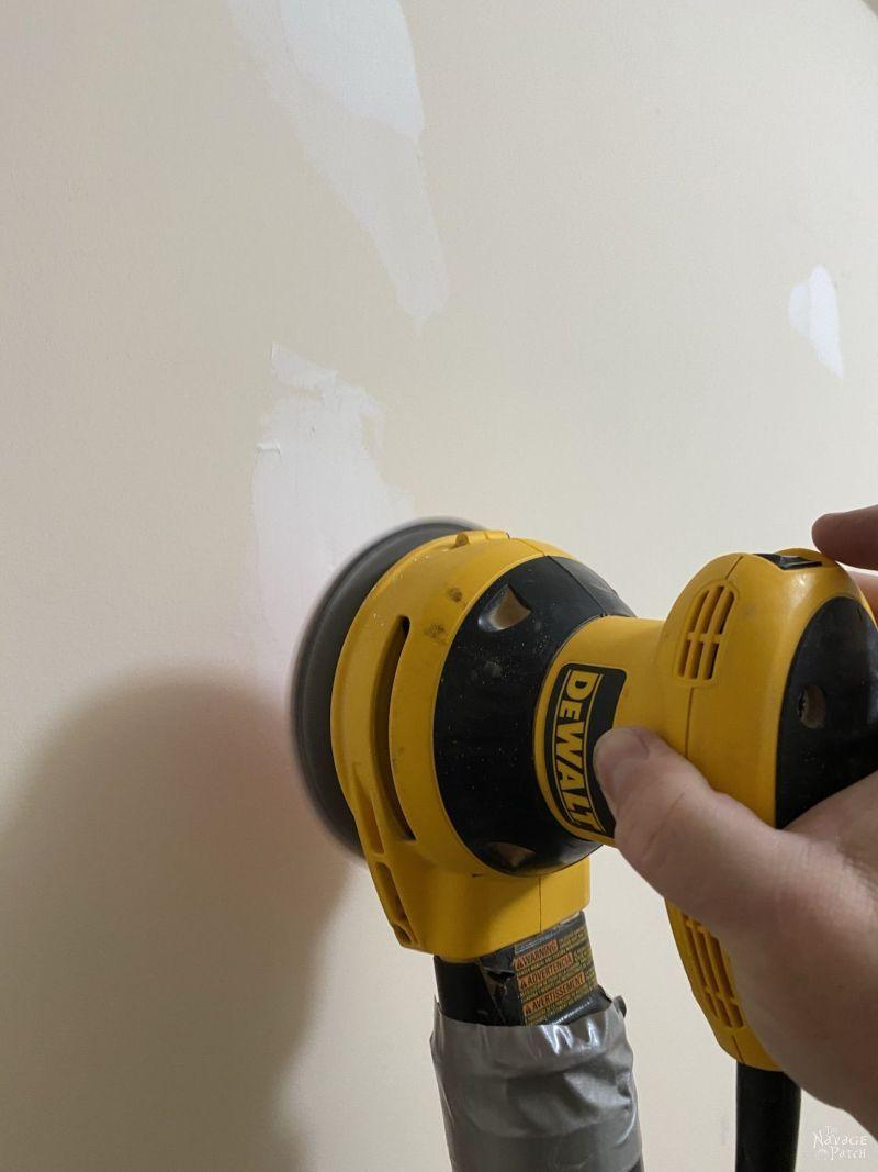 sanding drywall mud to repair holes