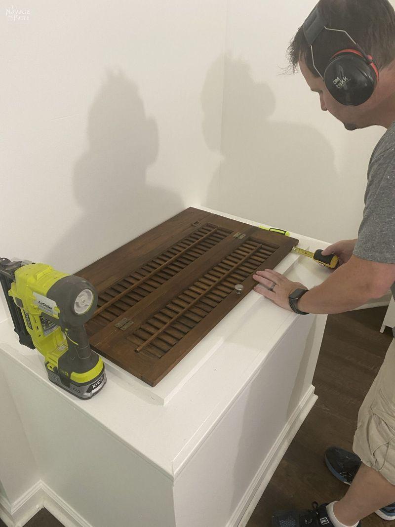 installing a repurposed plantation shutter laundry chute lid
