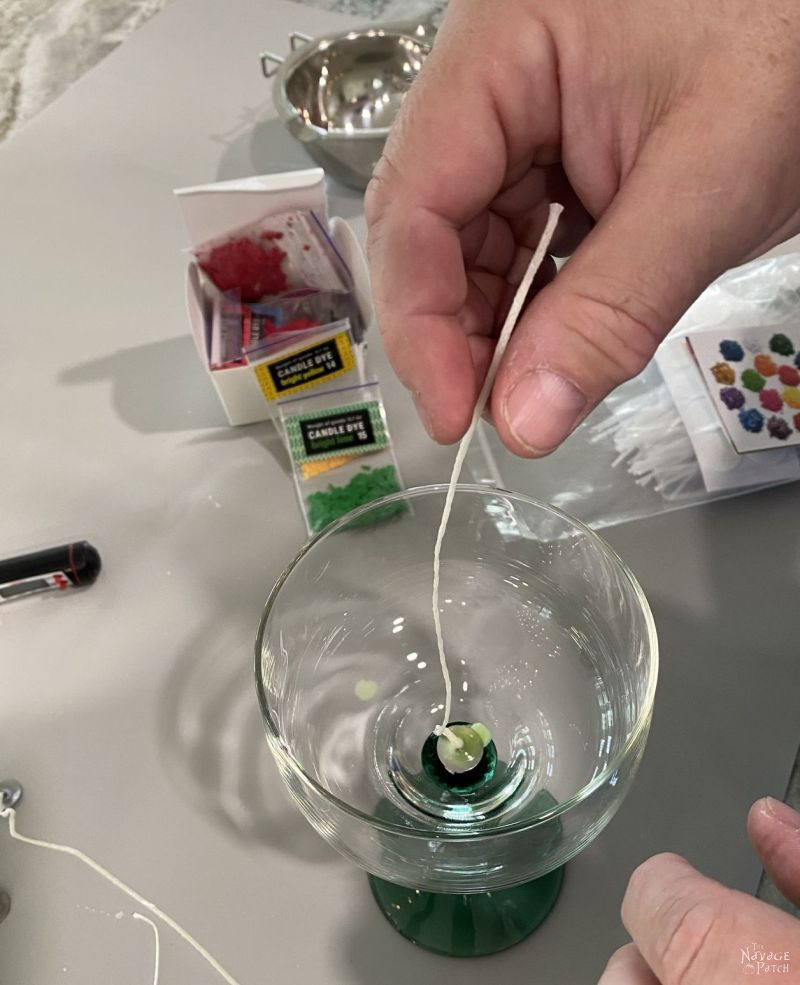 putting a wick in a margarita glass for citronella candles