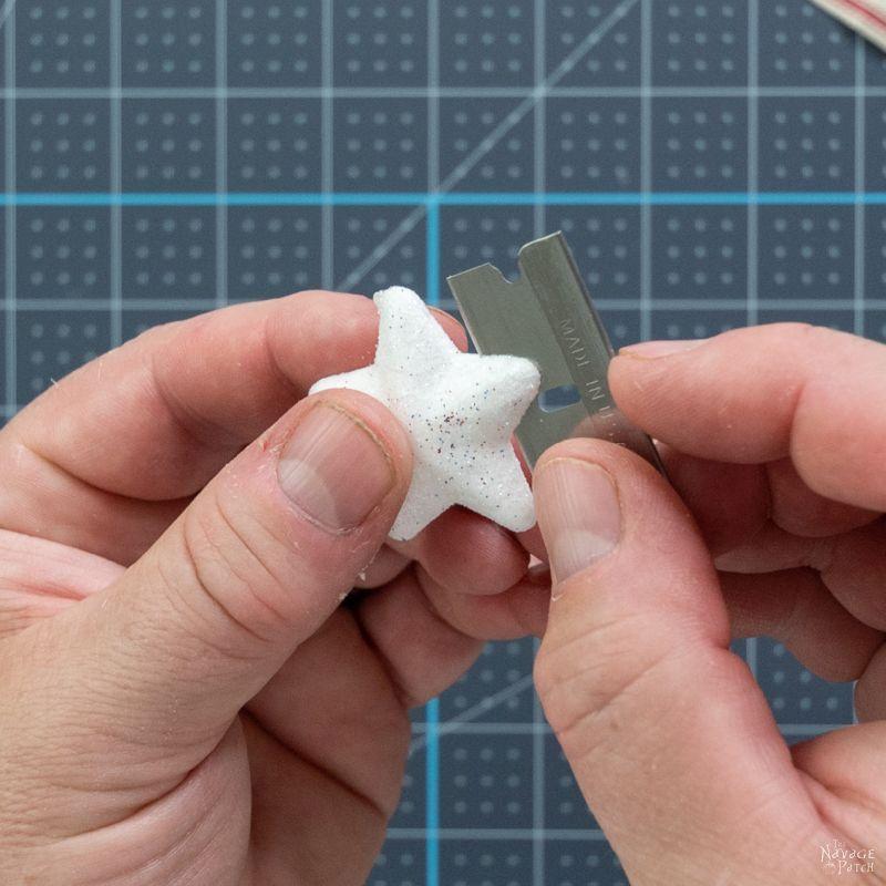 cutting a styrofoam star in half