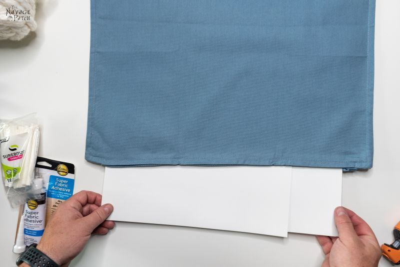 inserting cardstock into pillow cover