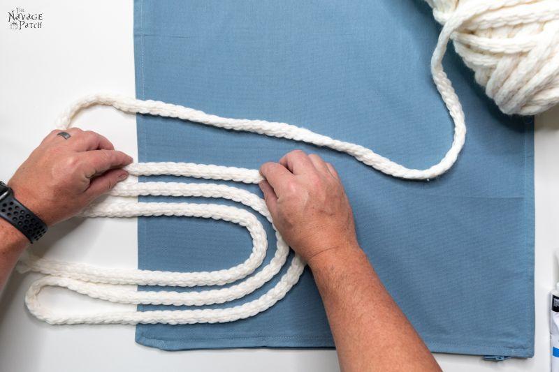 arranging yarn for diy throw pillow