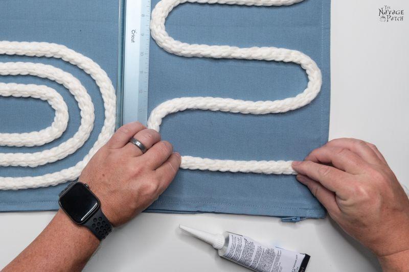 gluing yarn to diy throw pillow