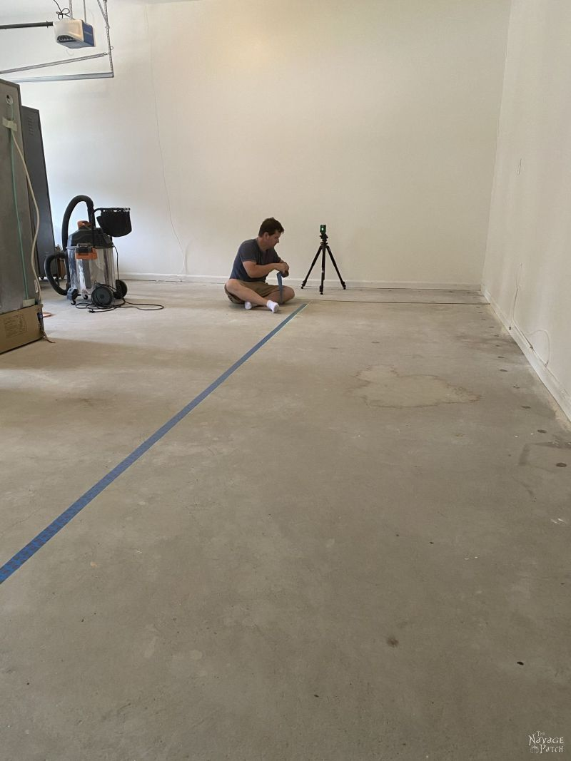 taping off the garage floor for paint