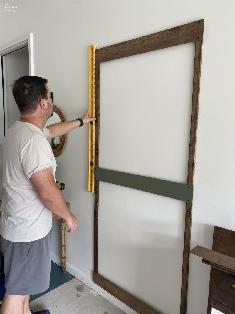 installing slats between two furring strips on a wall