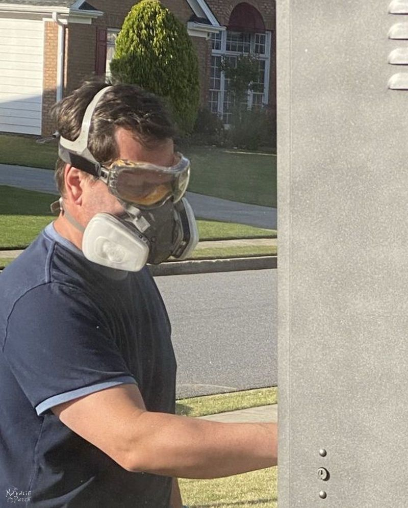 painting with a respirator and goggles
