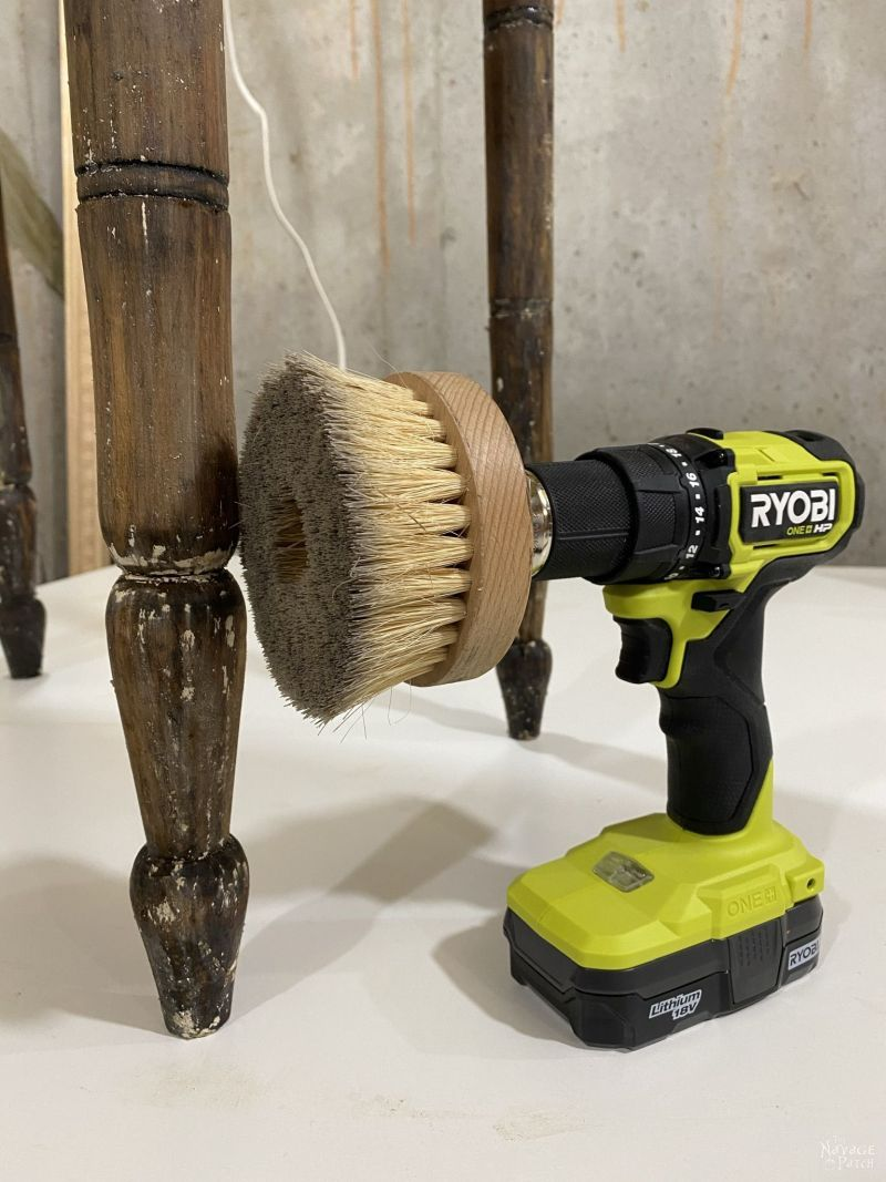 drill and brush next to a table leg
