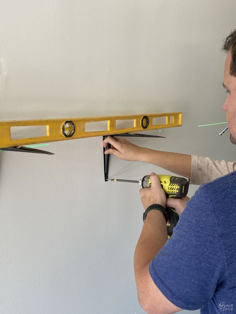 installing brackets to a garage wall with a laser level