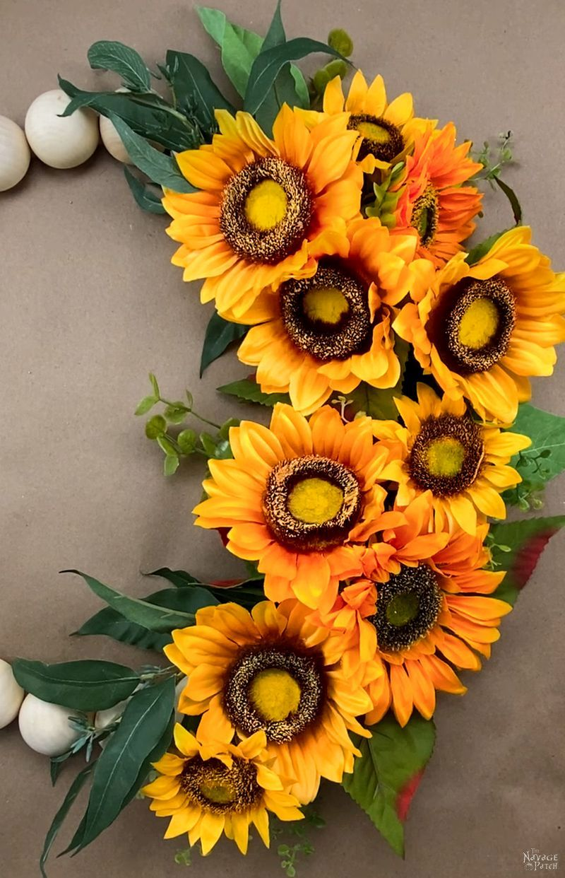 faux sunflowers glued to a wreath form