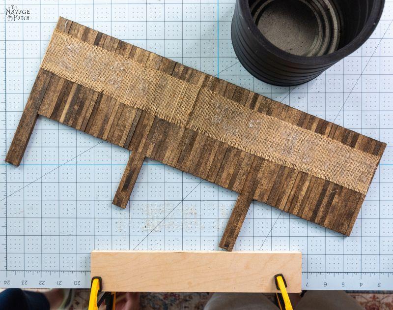 wood dowels glued to burlap