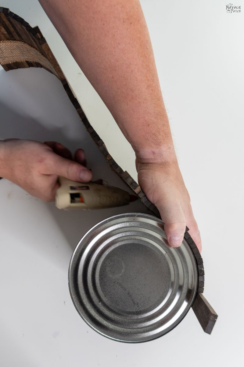 gluing dowels on a coffee can
