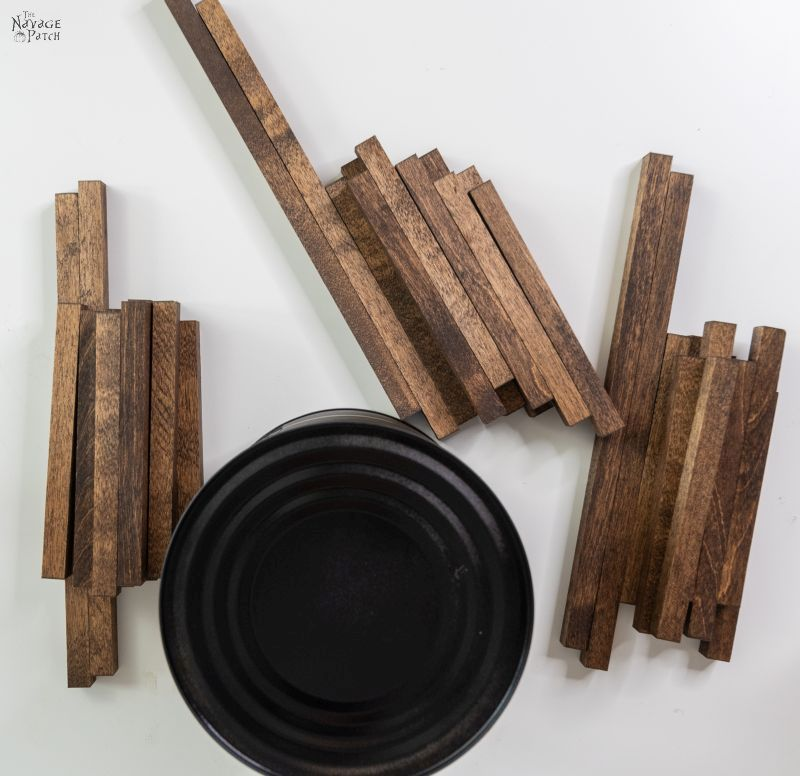 wood dowels and a black painted coffee can on a table