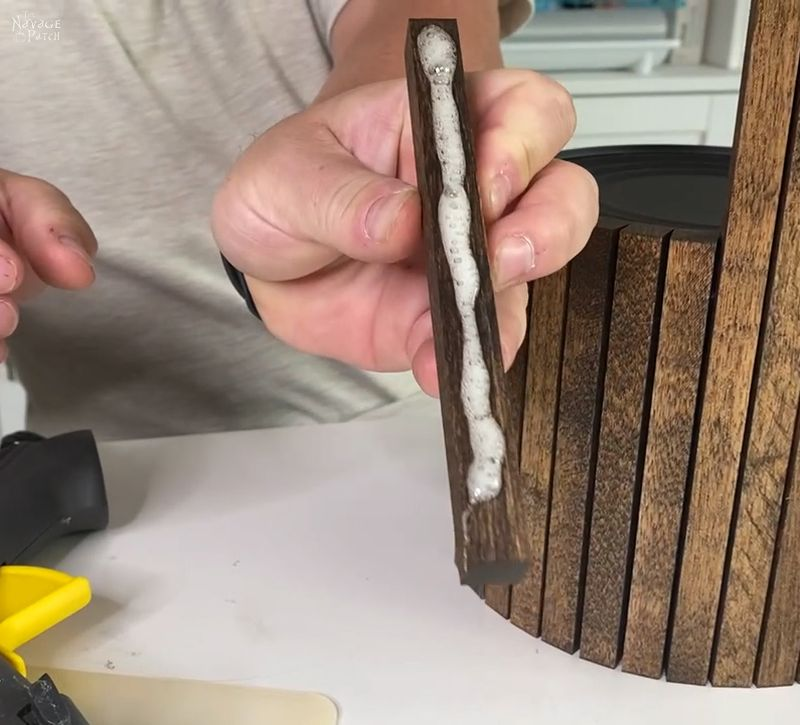 line of hot glue on a wood dowel