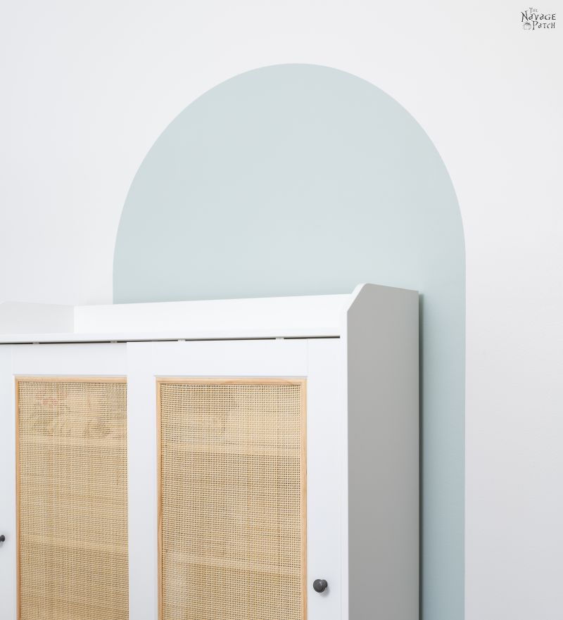 furniture offset from a painted arch accent wall