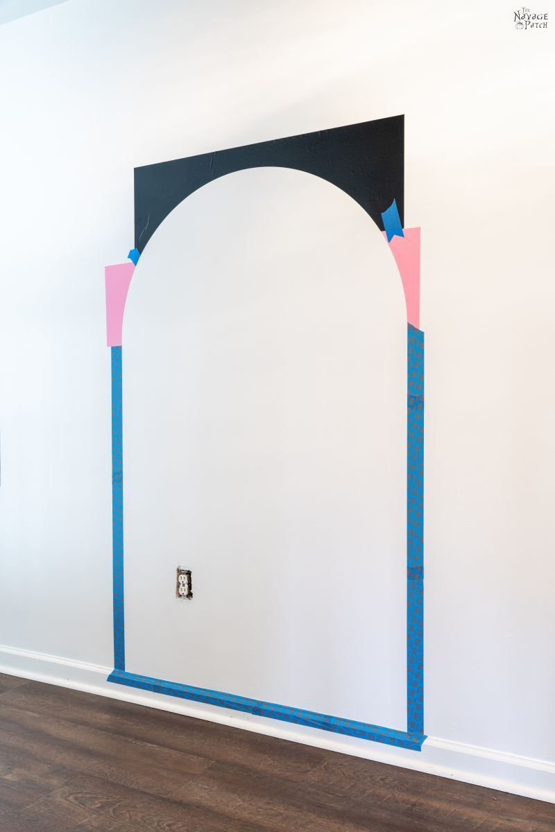 stencil on a wall for a painted arch