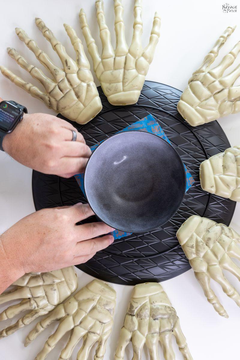 man gluing a bowl to a platter