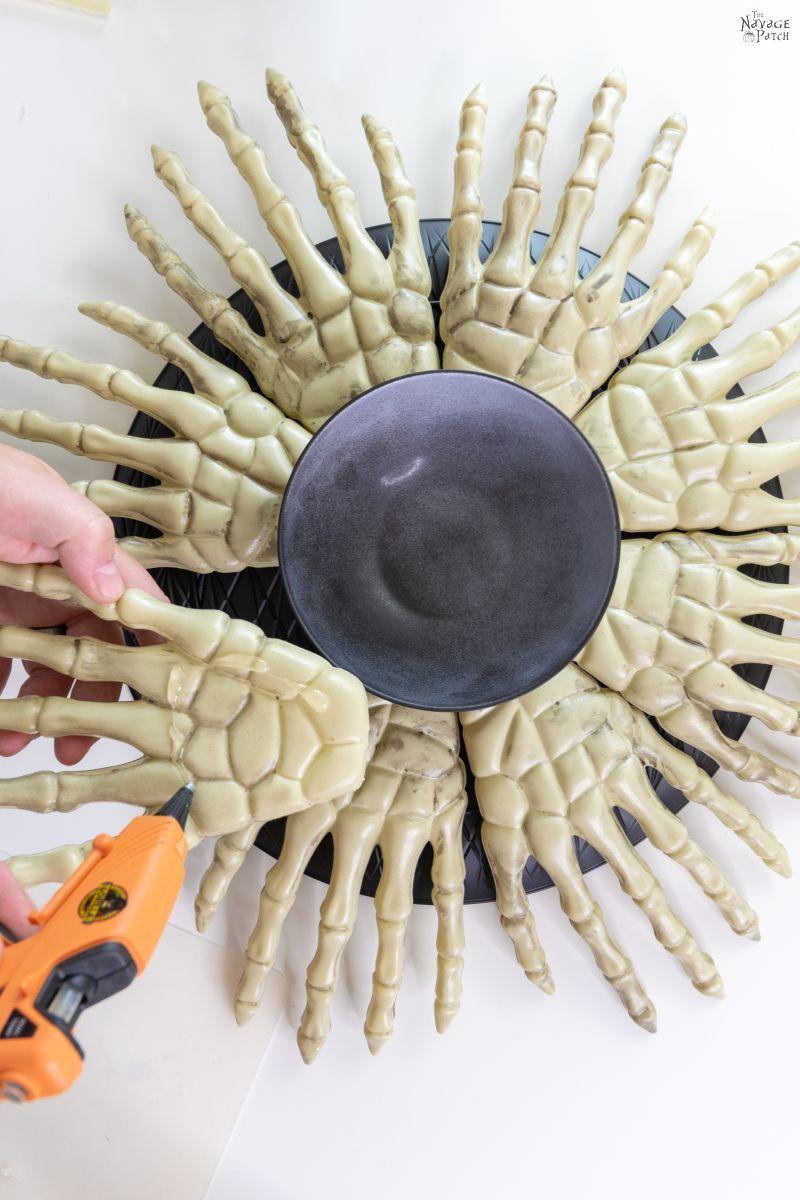 gluing skeleton hands on a platter
