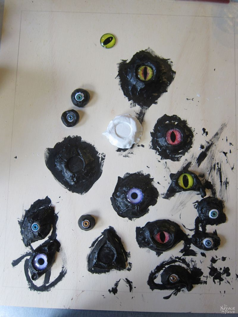 glass eyes and black-painted clay sockets