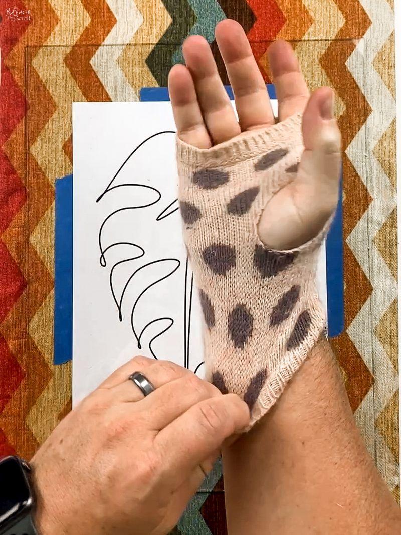 man putting on a polka dot glove
