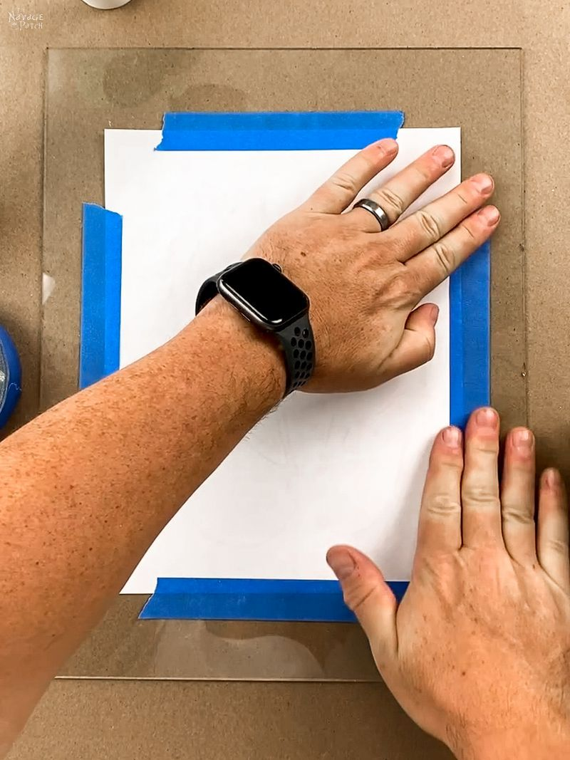 taping a line art template to frame glass