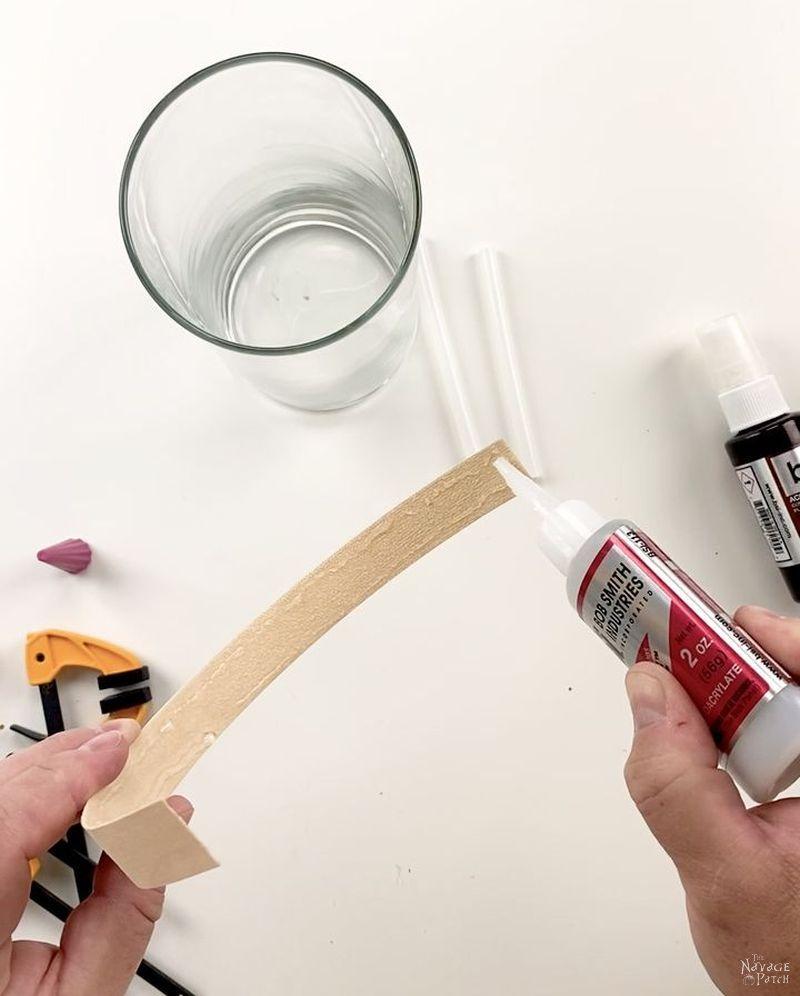 man applying super glue to edge banding