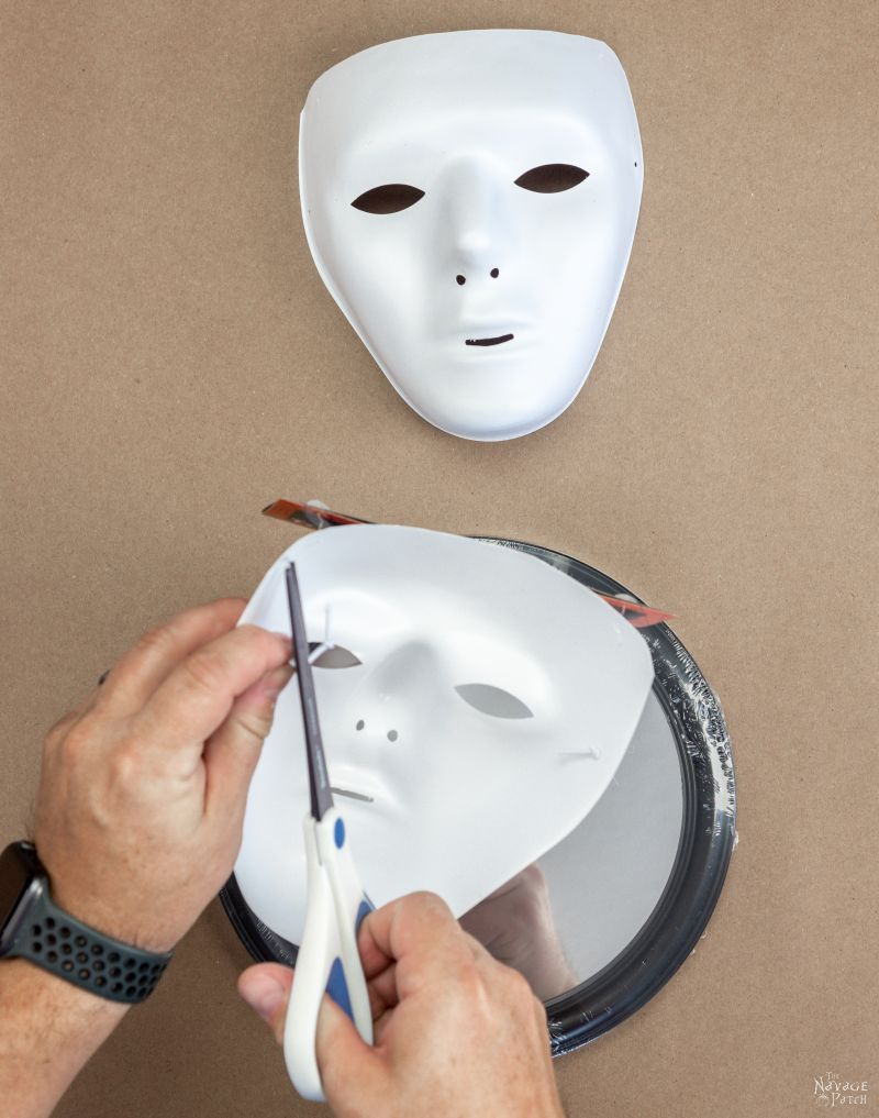 cutting the headband from a halloween mask
