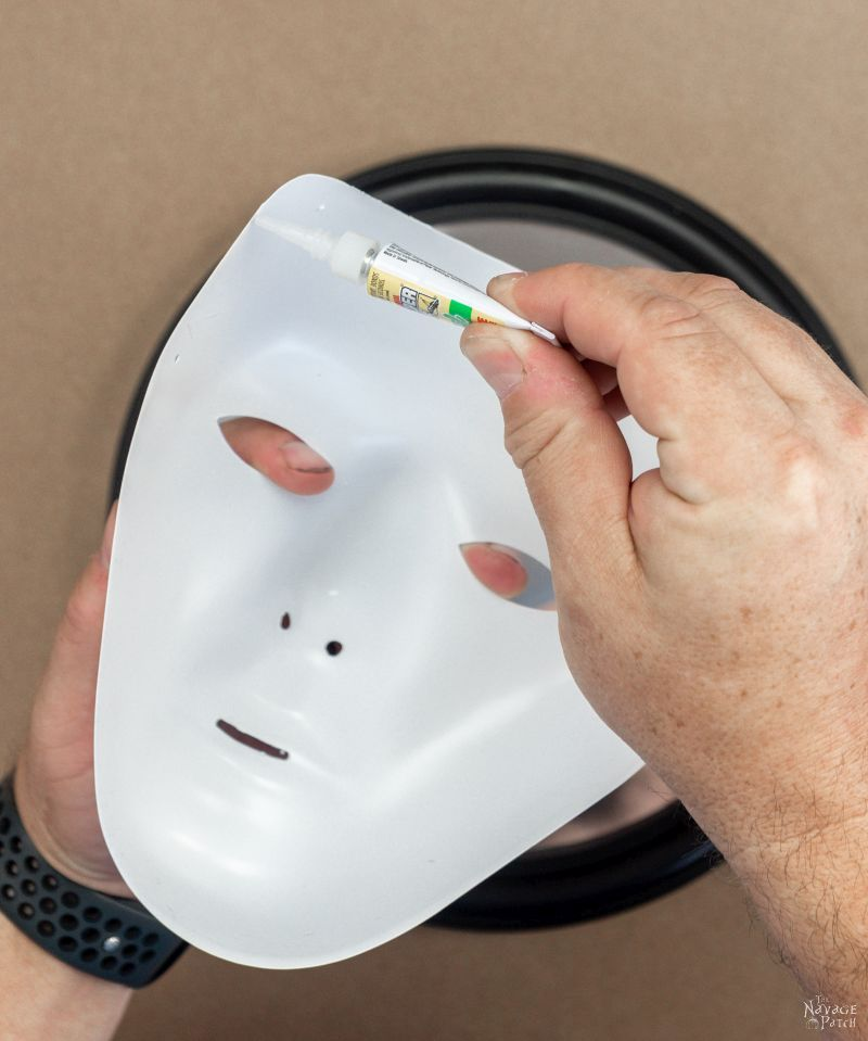 putting super glue on a halloween mask